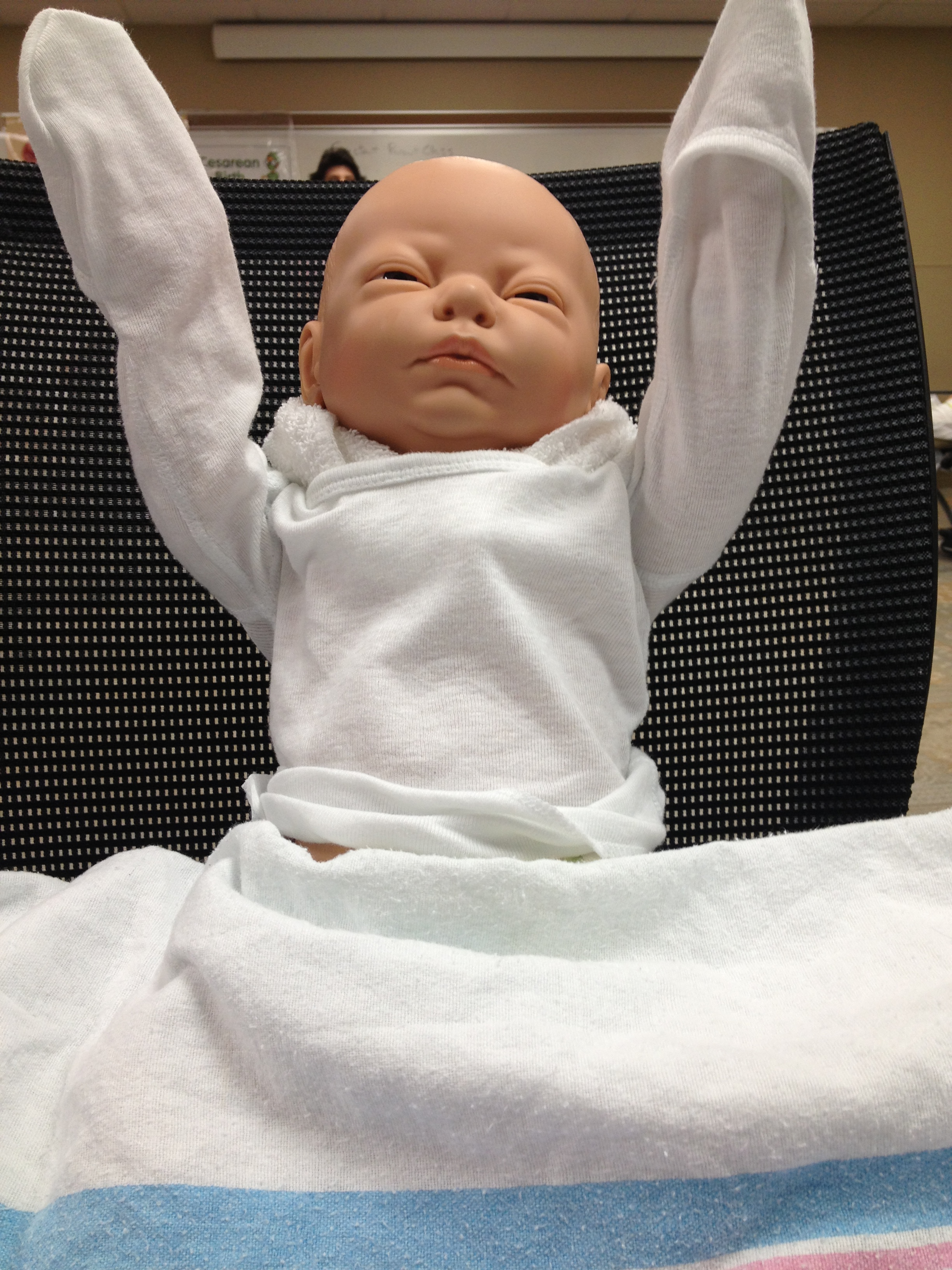 Dustin said our practice doll is excited for a touchdown.  Yep. We took this very serious....
