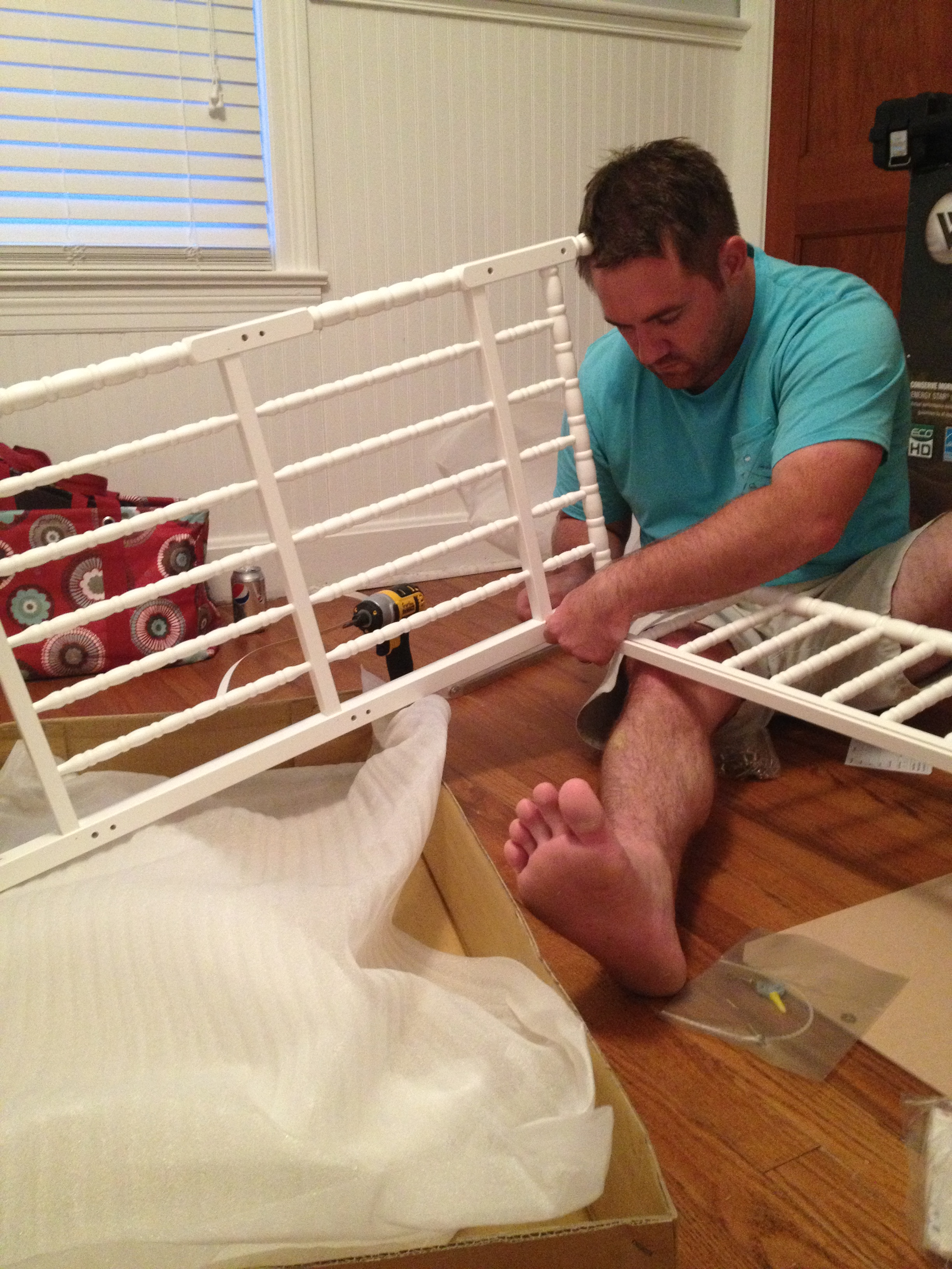 Dustin putting together our changing table!!